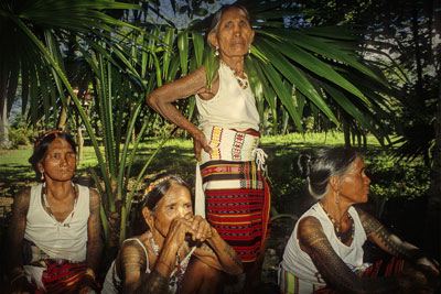 Tattooed Kalinga women waiting for a portrait at the Batok Festival.