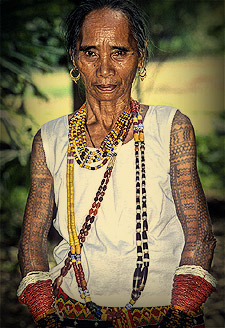 The beautiful bead ensembles circling the wrists of this Kalinga woman are called tinali.