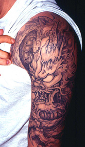 Dragon tattoo by Junior Perez and Sosa.