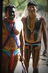 Right, the shaman Tuiarajup. He uses a jaguar bone whistle to communicate with the spirit world; it never leaves his neck. The jaguar is considered to be one of the most powerful animals living in the Xingu. It is associated with the sun, and Xingu chiefs and shamans often wear jaguar-skin headbands, armbands, or belts to associate themselves with this powerful predator.