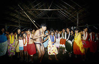 Tuiarajup leading a Jawosi dance in the community hut. Today, these all-night occasions, which can last up to several weeks, are celebrated to mark the beginning of another male initiation cycle.