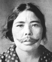 Ainu women with tattooed mouths, ca. 1900.