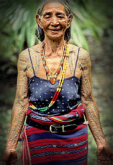 Heavily tattooed arms and beaded bodies make for timeless beauty at the Batok Festival!