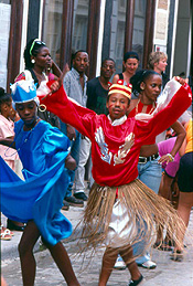 Santería street performance. This religion, based on saint worship and animism, is a fusion of Catholic and West African tribal beliefs that have been popular in Cuba for over 300 years.