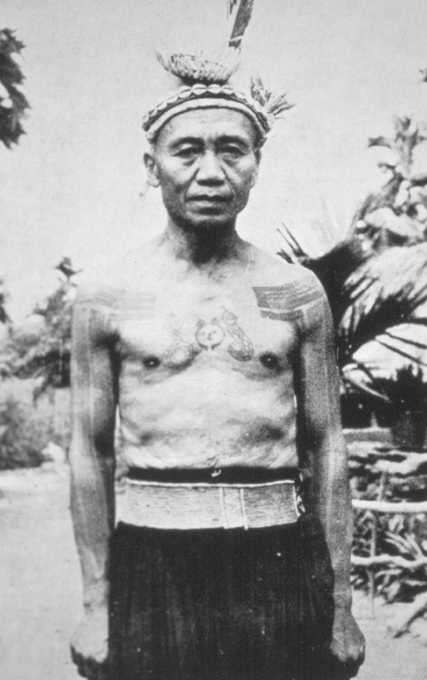 Paiwan headhunter's tattooing, ca. 1930. Note the tattoo of the 'hundred-pace viper' in the center of the chest flanking the tattoo of a human head. These snakes were symbolically tied to 'the spirit of life, the greatest of all spirits' in Paiwan mythology.